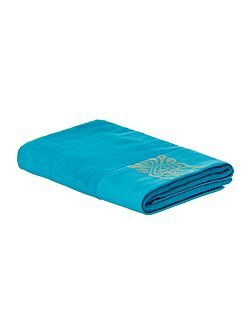 Gold logo bath towel in teal