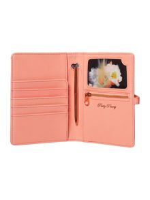 Light orange document holder with pen