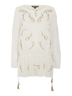 Feather embellished longline blouse