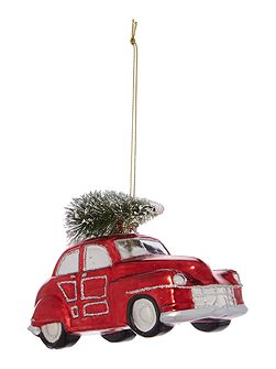 Red beetle car with tree decoration