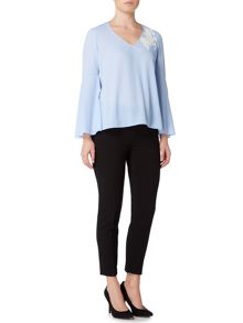 Ellen Tracy V neck blouse with bell sleeve and embroidery