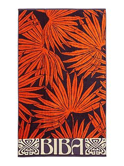 Orange palm beach towel