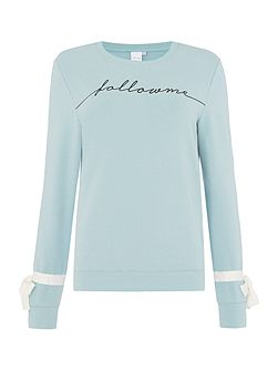 Slogan long sleeve knitted jumper with bow detail