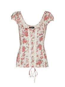 Floral print top with lace detail.