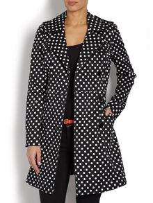 Trench coat with spotted patterning