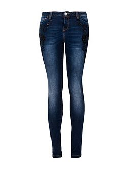 Slim-fit jeans with oriental embroidery