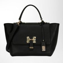Handbag with hardware embellishments