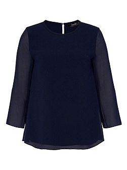 Blouse with back pleat