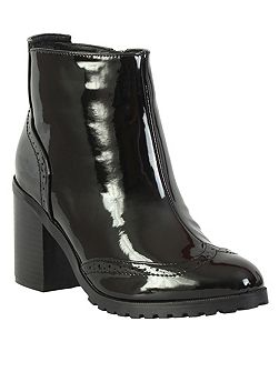Heeled brogue boot