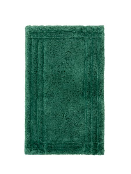 Christy These bath rugs are both luxurious and absorbent