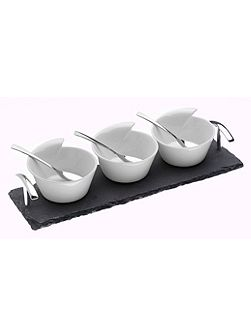 Set of 3 ceramic bowls and spoons on