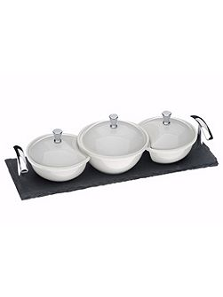 Set of 3 covered dishes on a slate