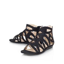 Turntable flat strappy sandals