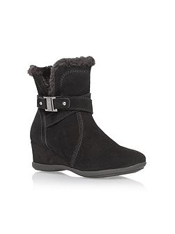 Incaged low heel fur lined boots