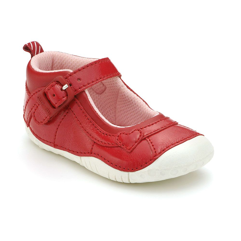 Girl`s bright red patent shoes