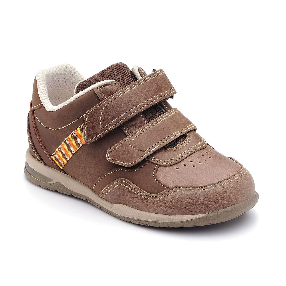 Boy`s bright brown leather shoes