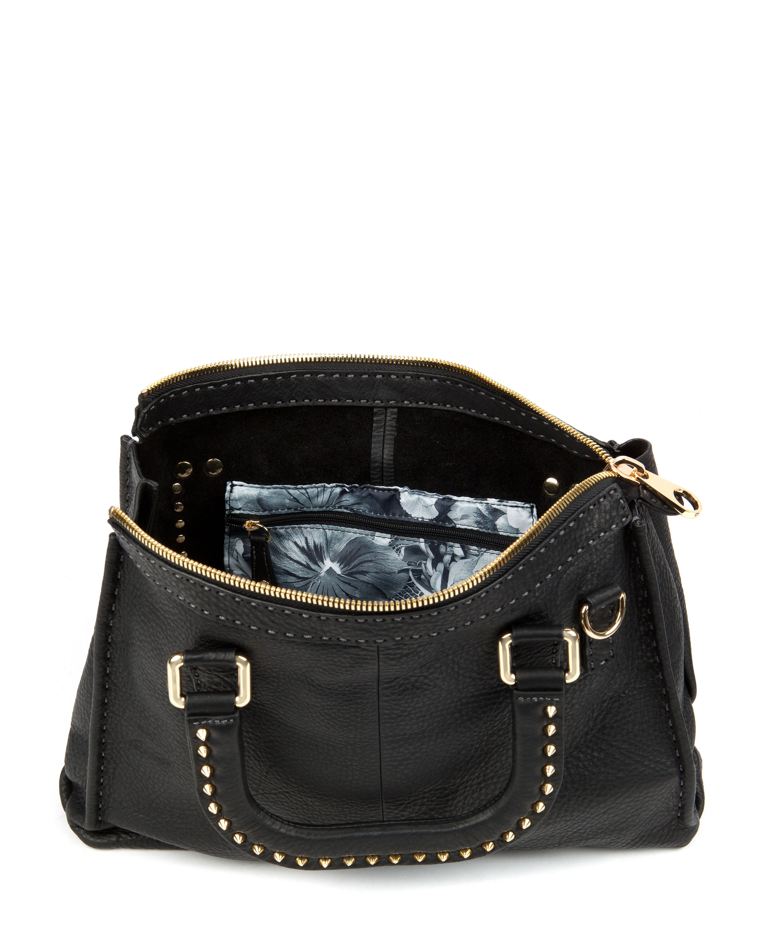 Studory leather stud stab stitch bag
