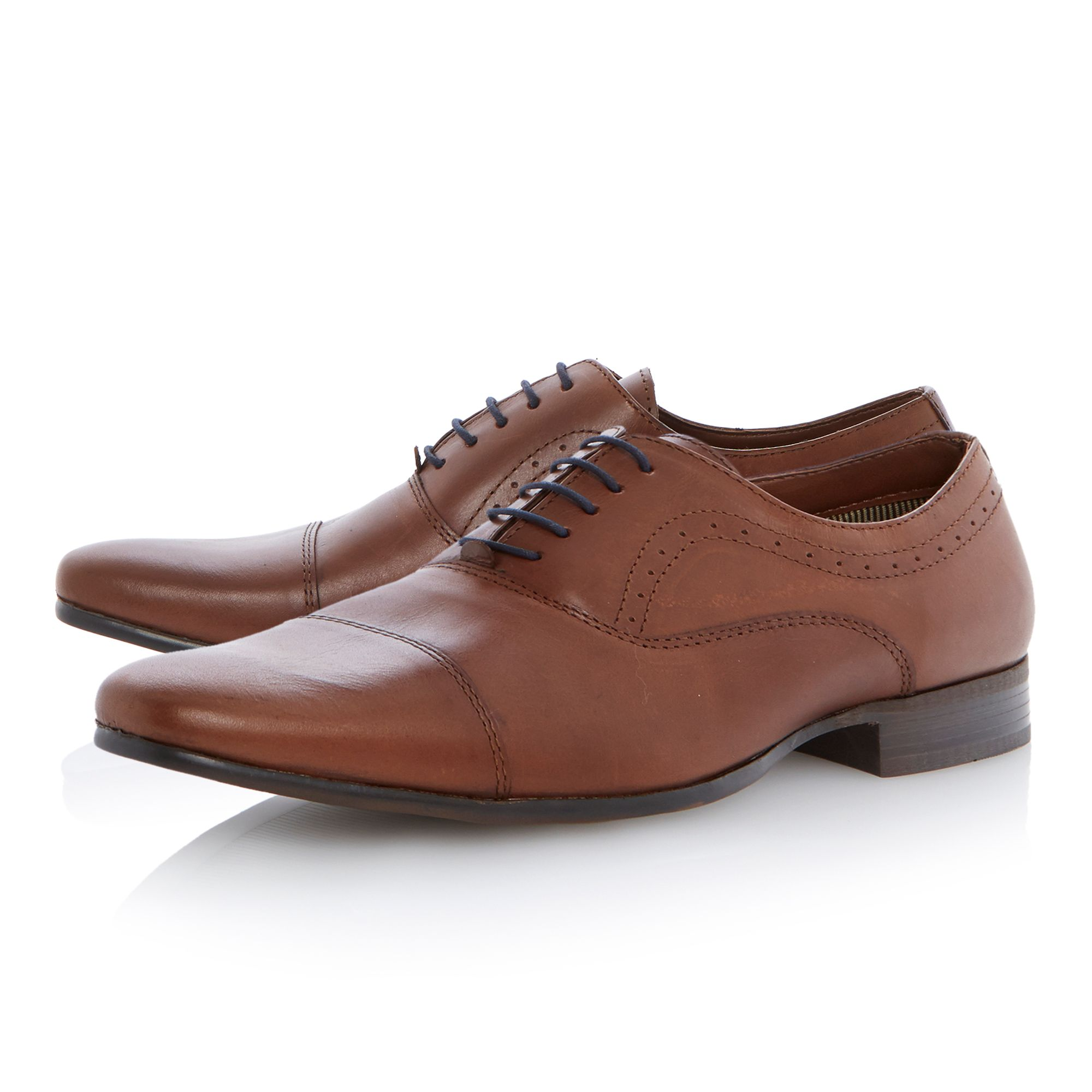 Actors lace up formal shoes