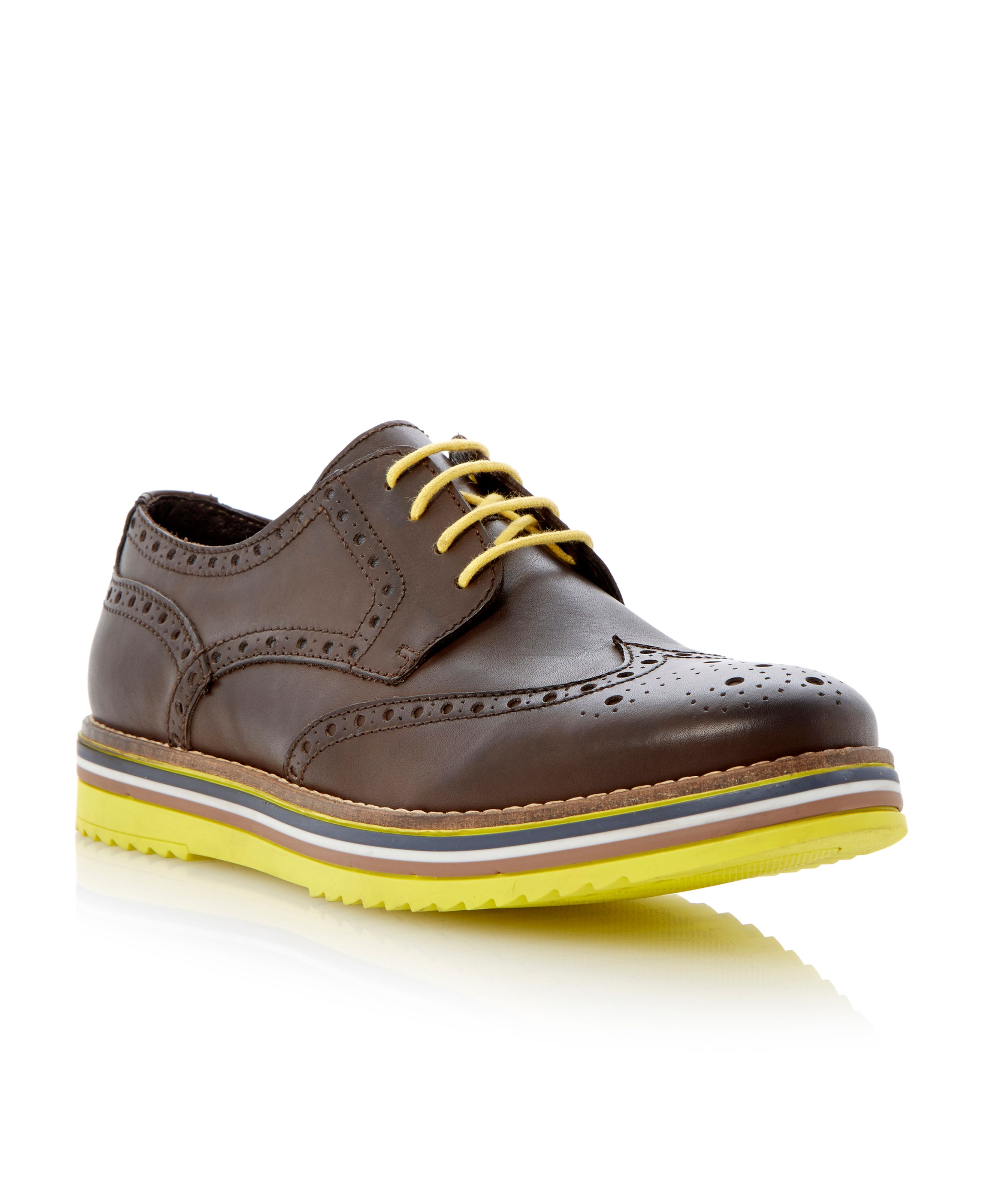Bumbled leather contrasting sole brogue