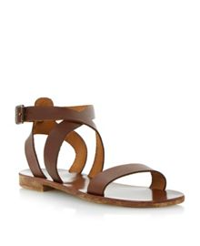 Jumpy leather flat buckle sandals