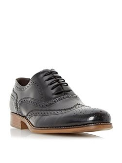 Rogue patent brogue shoes