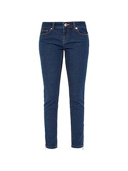 Super-skinny mid-wash jeans