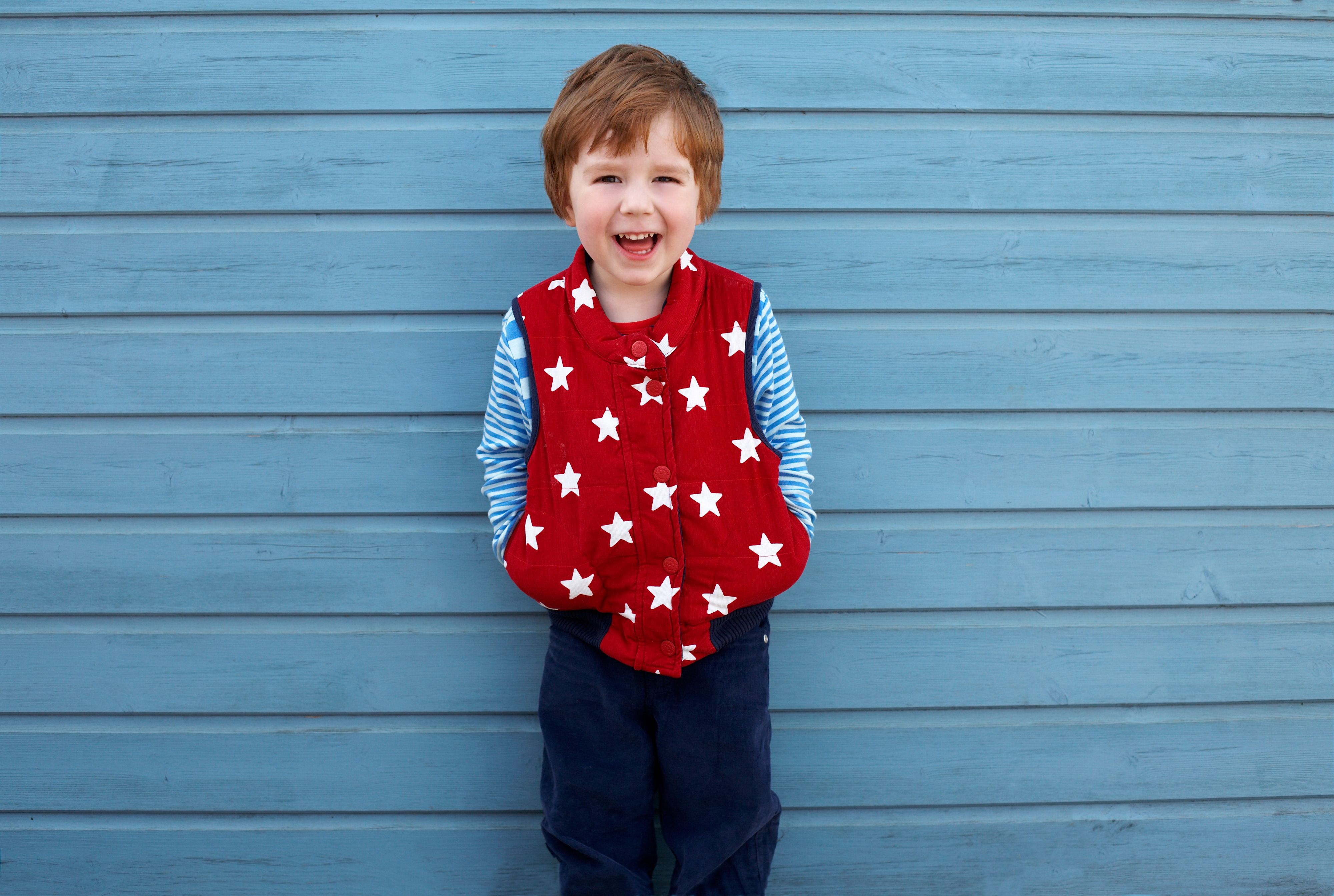 Boy`s reversible cord gilet with stars