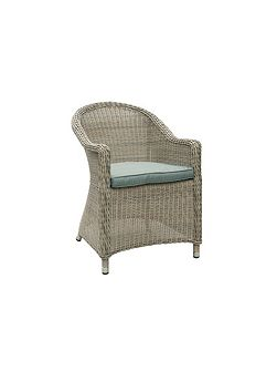Hampton rattan arm chair with round back in
