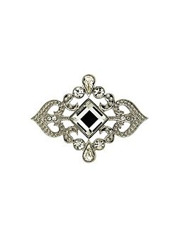 Silver and crystal scroll brooch