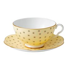 Polka dot tea cup and saucer yellow