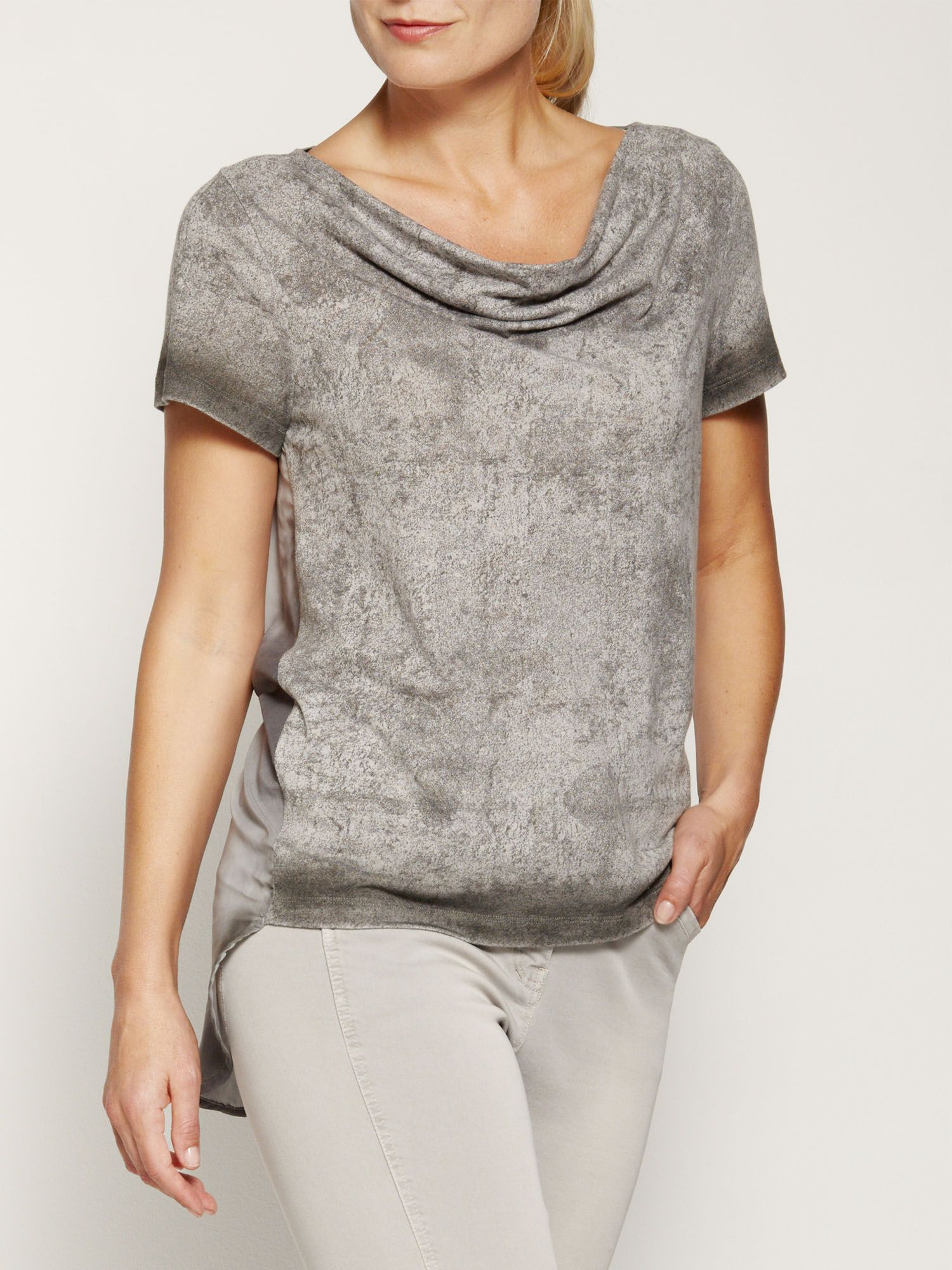 Blouse with irregular hem
