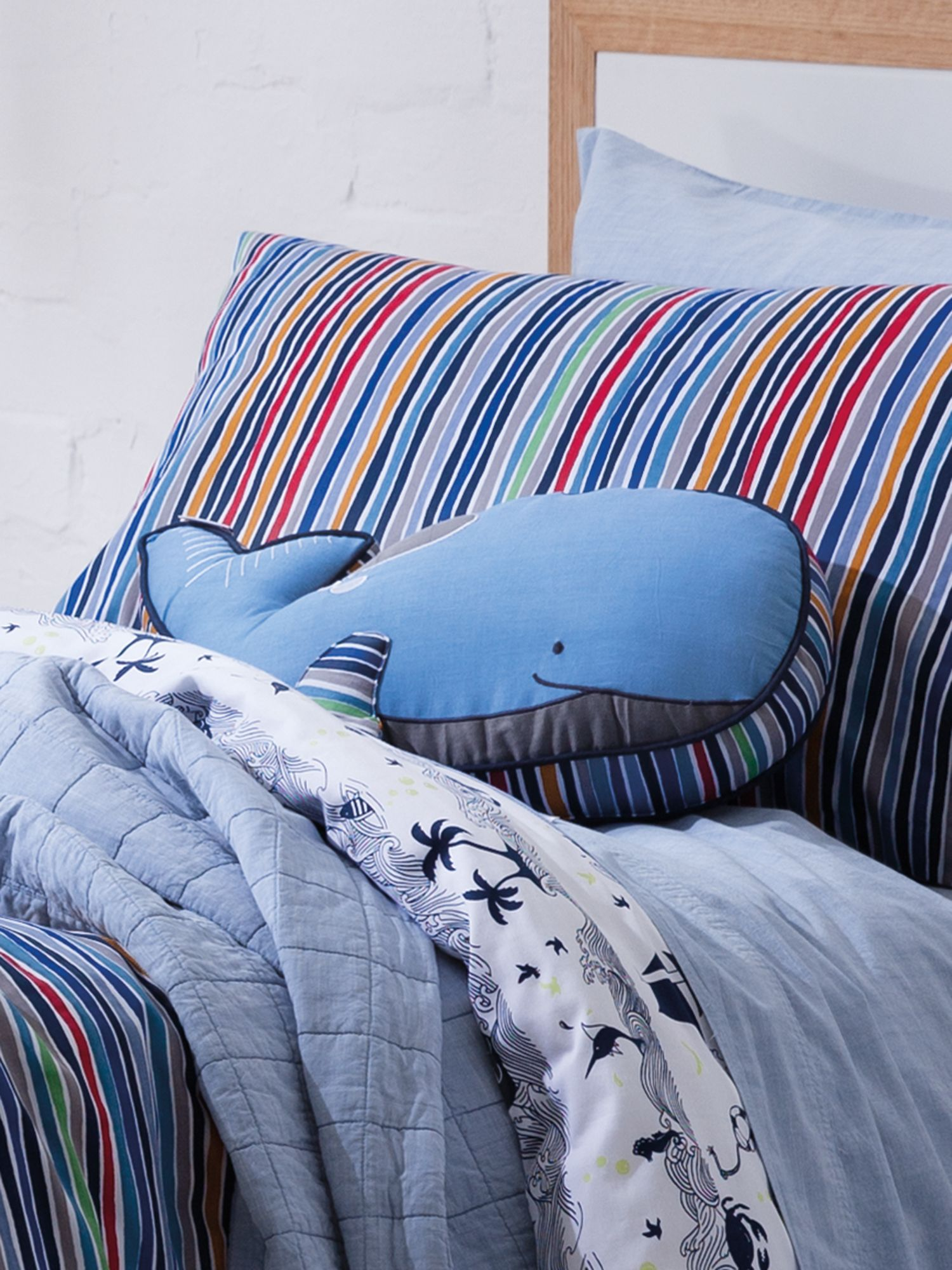 Leo phoenix cushion, whale shaped