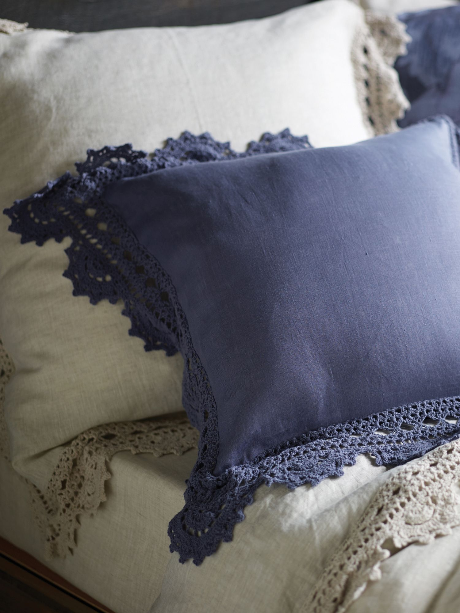Evelina indigo cushion, handmade crochet trim