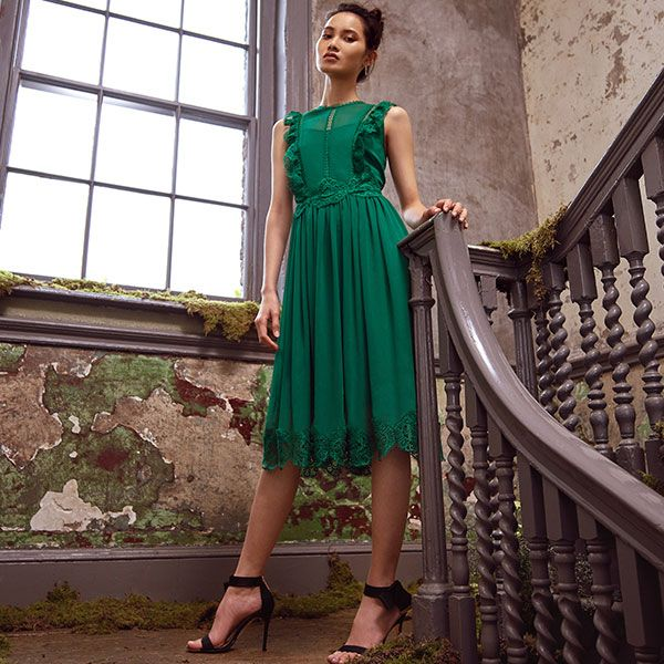 Woman wearing green ted baker dress